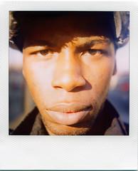 futures so bright (I gotta wear shades) (Js) Tags: light portrait sunlight me hat closeup self polaroid sx70 background 600 epson sonar polarizer onestep v700