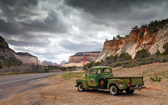 watching the road (Craignos) Tags: park sky orange cliff green chevrolet station truck utah rocks cloudy entrance gas national rusted zion flickrshop byway9