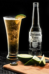One Down (Photoshoparama - Dan) Tags: lighting stilllife beer corona lime strobist mystilllife darkfieldlighting afmicronikkor60mmf28 dsc3402 johnsongraphics photoshoparama danielejohnson crossroadonecom sometinesitjustallcomestogether
