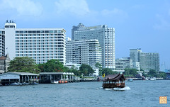 A house boat on the Chao Phraya River in front of Shangri-La Hotel, Bangkok, Thailand.PhrayaRiver-Bangkok-2009-KQN (KQN Images) Tags: bangkok houseboat shangrilahotel