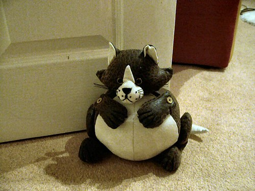 Cute kitty doorstop