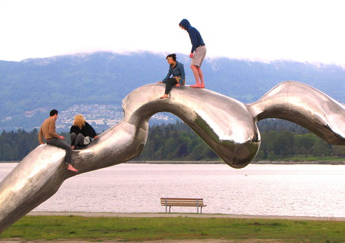 People having fun on Liquid Frozen sculpture in Vancouver's Vanier Park