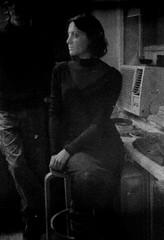 canonet_073 (mariczka) Tags: blackandwhite bw woman white black film girl vertical analog canon chair noir sitting iso400 rangefinder listening brunette blanc canonet 45mm blackdress blancinegre f19 damagedfilm audel canoncanonet vintageanalogue canoncanonetoriginal ufofilms