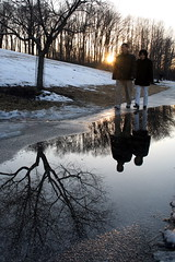 Hand in Hand (imageining) Tags: trees winter sunset sunlight lake snow reflection tree water grass lens puddle centennial wire md melting couple mesh weekend walk pair perspective maryland diagonal sidewalk lensflare flare asphalt stroll stable