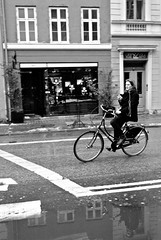 Reflecting on a message. (tim clements) Tags: street copenhagen streetphotography bikes bicycles sms textmessage mywinners leicam8 elmaritm28mm