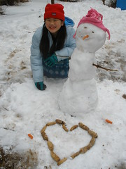 Sophia with Snowman Bird Feeder and Pinecone Heart