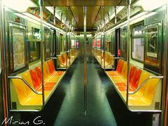 7 train in main street (Mirian G.) Tags: street nyc red orange yellow train ads map g empty main 7 pole busy corona seats mta poles mirian 111st