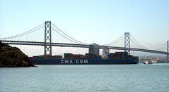 Container Ship sailing under Bay Bridge