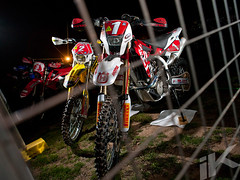 Caged Beasts (iKapture®) Tags: red black night canon honda eos offroad racing suzuki titanium 2009 580ex enduro trailriding husqvarna wr450f offcamera ohlins acerbis te450 progrip rmz450 1dsmarkiii canon1dsmarkiii ikapture a4de