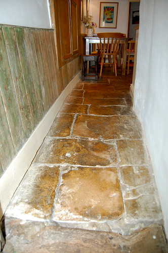 Flagstones worn with generations of tread