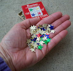 Hand with gummed stars