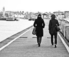 Friends walking by the sea (I'mMarco) Tags: life street friends sea people bw girl clouds walking freedom friend mare gente cielo language spiaggia molo amica ragazza fano perpsective nikond40 fanoinfoto immarco