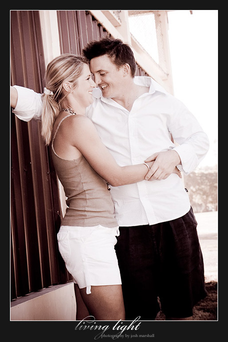A hug behind the shed. Engagement session at Speers Point, Lake Macquarie, Newcastle.
