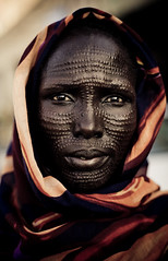 Nuer (Swiatoslaw Wojtkowiak) Tags: africa portrait woman tattoo female canon mark sudan middleeast tribal 5d canon5d tribe ethnic scar khartoum scarification bodymodification indigenous adornment soudan tattooing omdurman nuer 0492  facialtattoo szudn sudo