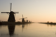 Dutch Windmiles at Sunset (Bas Lammers) Tags: winter sunset netherlands windmill canon kinderdijk awesomeshot 50d platinumheartaward flickrestrellas bestofmywinners mygearandme mygearandmepremium mygearandmebronze mygearandmesilver mygearandmegold mygearandmeplatinum mygearandmediamond