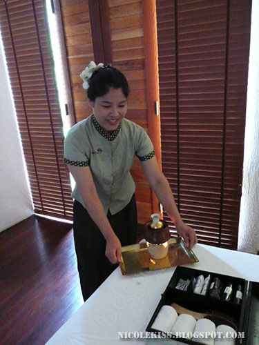 massuer preparing massage oil