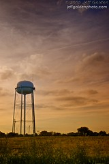 Towering Under a Cloudy Sky (jeff_golden) Tags: sky field clouds watertower explore explored nikcolorefexpro 1755f28is pad2009 bicolorfilter photoaday2009 explorehighest215