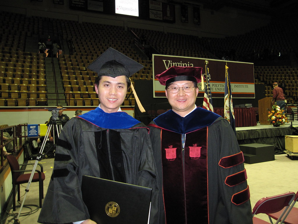 Prof. Hou and I in Front of the Stage