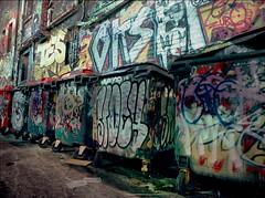 garbage day parade #2 (mugley) Tags: city longexposure urban colour 120 film wall night trash mediumformat prime graffiti alley 645 kodak bricks australia melbourne wideangle tags gritty victoria dirty scan negative similar lane rubbish wheeliebins dumpsters epson cbd skips 6x45 bins nocturne mamiya645 urbanlandscape ektar grotty c41 v700 mamiya645protl m645 rutledgelane kodakektar100 ektar100 trashclams 35mmf35sekorn gettyreject