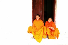 Laos - as pure as white (... Arjun) Tags: door wood portrait 15fav orange brown white black color colour topf25 colors 1025fav 510fav portraits 35mm canon iso100 asia colours buddha buddhist monk buddhism 100v10f f45 2550fav 500v50f monks 50100fav overexposed laos pure 2009 mekong luangprabang holyman indochina luangphrabang luangphabang louangphrabang canonef24105mmf4lis bluelist laospdr watsirimungkhun unescoworldheritagecity canoneos5dmarkii 5dmarkii thsakkarin aspureaswhite