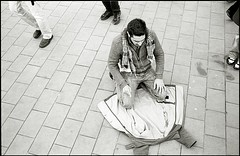 A man prays (quixotic54) Tags: leica uk greatbritain england bw london film 35mm square blackwhite fuji unitedkingdom britain islam pray praying protest trafalgar rangefinder mount summicron 400 neopan coolscan m6 asph leicam6 xtol nikoncoolscanved summicronm mmount np400pr fujifilmneopan400 autaut leicasummicron35mmf20asph