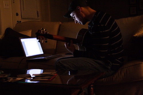 jon practicing guitar by computer-light