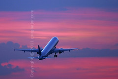 Commercial airplane taking off (Greg Bajor) Tags: uk blue sunset red england sky clouds plane sunrise airplane flying britain dusk aircraft aviation air united great jet kingdom down aeroplane commercial airline airbus takeoff atmospheric airliner aerospace flaps a321 mywinners theunforgettablepictures gregbajor