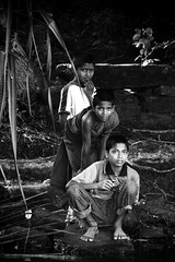 On the lookout (CJ Dias Abeyesinghe) Tags: people canon children eos monks srilanka 450d childrenofsrilankabw koggalalake efs55250mmf456is