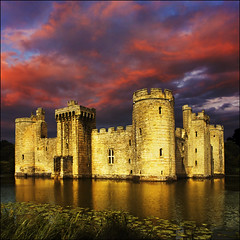 Moods of Bodiam Castle (adrians_art) Tags: sky cloud storm reflection castle water weather buildings sussex evening ruins structure bodiam moat stronghold