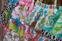 fancy25 (gock's frocks) Tags: pink flowers orange black birds ribbons aqua ebay handmade polkadots clothesline lime skirts ets michaelmiller flightsoffancy limevine gocksfrocks paulaprass