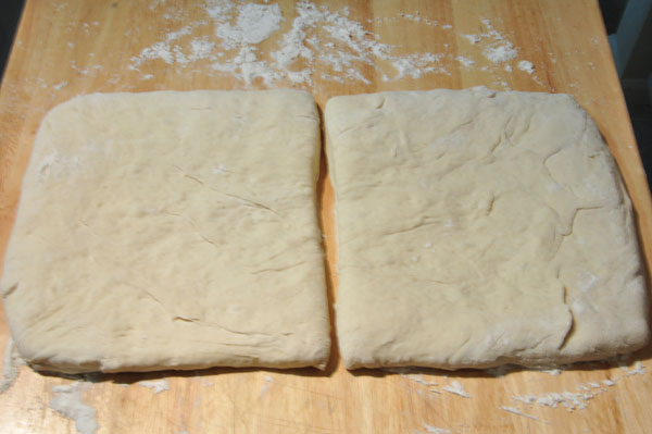 bread dough flattened and divided after three days cool fermentation