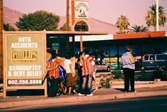 Main Street #20: Waiting (kevin dooley) Tags: auto street bus film phoenix analog 35mm photography xpro crossprocessed waiting minolta main driveby slide busstop stop queue wait tungsten theft fujichrome insurance bankruptcy xgm t64 iso64