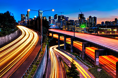 Freeway Flow (Surrealize) Tags: road seattle street city longexposure sunset motion tree cars sign skyline buildings lights drive washington nikon colorful neon cityscape traffic i5 crane fast onramp pole mercer evergreen lane freeway barrier headlight express railing curve hdr taillight expresslane 9exp d700 surrealize overpassskyscrape