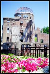 A-Bomb Dome Blur (NateVenture) Tags: color film japan nikon radiation slide hiroshima ww2 positive pancake nikkor e100vs wmd atomicbomb abomb abombdome  fe2 tessar  45mmf28pais 4528 4528p 4528s kodakekatachrome100vividsaturation iwakuni