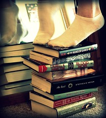 Day 45: I've Been Busy (Lisa.Christine.) Tags: feet socks reading books day45 uglies seeingred 365days thegoldencompass threesixfive 45365 thehost thesweetfarthing bloodnoir thehungergames deadlylittlesecret