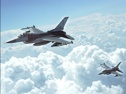 F-16's Flying High above the Clouds