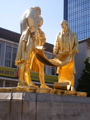 Watt, Boulton, Murdoch gold leaf statue (ell brown) Tags: greatbritain england statue bronze birmingham unitedkingdom civiccentre murdoch plinth westmidlands watt goldleaf portlandstone boulton broadst jameswatt matthewboulton thegoldenboys williammurdoch bloye boultonwattandmurdoch williambloye threestandingfigures gildedbronzestatue regilded thecarpetsalesmen raymondforbeskings groupeddiscussingdrawings partiallyrolledupplanofasteamengine richardwheatley
