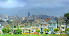 Painted Ladies (Jill Clardy) Tags: street houses homes ladies fog skyline square san francisco downtown day pastel district painted victorian fullhouse 100views 500views alamo financial hdr 1000views steiner npw 0609 photomatix 2009jillclardy