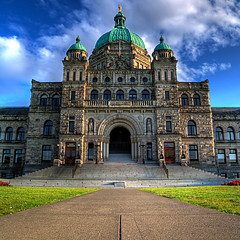 Halls of Power (ecstaticist) Tags: blue sky cloud canada postprocessed building history stone vancouver photoshop canon island harbor three back exposure bc angle image walk political politics rear wide parliament icon columbia victoria front tourist structure inner sidewalk architect walkway british neat noise legislature hdr entry materials rattenbury attraction precinct legislative sharpened postprocessing reduction granit 3x neatimage g10 onfrontpage