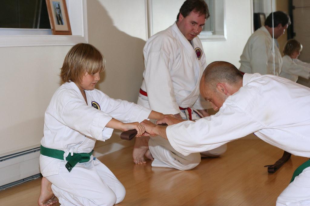 Wesley presenting Michael his brown belt