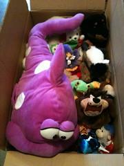 A box of unwanted stuffed animals