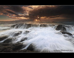 What do you do when a torrent is heading your way? (danishpm) Tags: ocean seascape clouds sunrise canon rocks wave australia nsw aussie aus 1020mm manfrotto waterflow sigmalens kingscliff eos450d 450d kingcliff tweedshire dragondaggerphoto waterfallaction sorenmartensen hitechgradfilters 09ndreversegrad