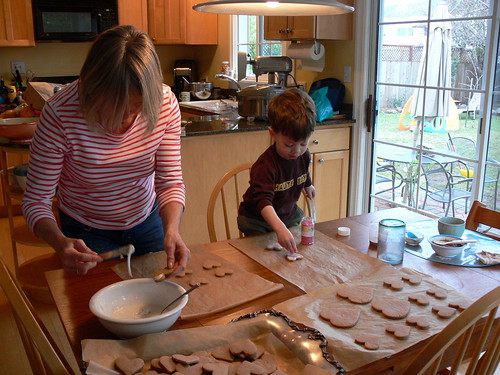 Mom and Davey decorate cookies