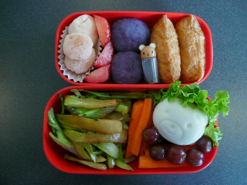 Box 1:  Dried Rambutan, strawberries, Okinawan potato balls, Inarizushi, bear sauce holder with soy sauce.  Box 2:  Broccoli stalk kinpira, carrot sticks, grapes and bear egg.  450 calories.