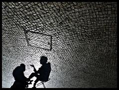 Fado I: Saln Limpiabotas / Bootblack Shop (Sator Arepo) Tags: street leica shadow sky reflection portugal stone chair sitting shadows floor lisboa lisbon streetphotography shades shade gradient paving conversation shoeshine dlux pavingstone limpiabotas bootblack dlux4 retofz090908 gettyimagesspainq1 iberiastreets gettyimagesiberiaq2