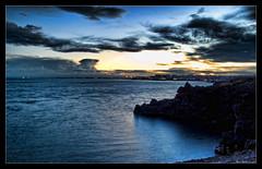 prime luci della sera (Andrea Rapisarda) Tags: longexposure sea geotagged rocks mare sicily coastline catania sicilia scogliera mywinners abigfave olympuse510 rapis60 andrearapisarda geo:lat=37538833 geo:lon=15131332