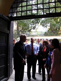 John McCain (left) greets staff of the Hoa Lo Prison Museum, Hanoi, April 8, 2009. Photo © Matt Steinglass.