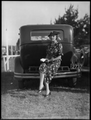 Woman sitting on bumper bar of a car at Warwick Farm racecourse (Powerhouse Museum Collection) Tags: woman tree grass car fashion sitting dress posing gloves vehicle buggy powerhousemuseum thomaslennon 2737 tomlennon xmlns:dc=httppurlorgdcelements11 dc:identifier=httpwwwpowerhousemuseumcomcollectiondatabaseirn388486 warwickfarmracecourse thomastrembathlennon