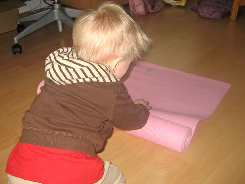 Jacob loves rolling up the mat