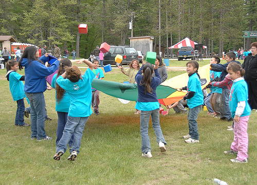 Menominee children enjoy their play at the LMIC kickoff.